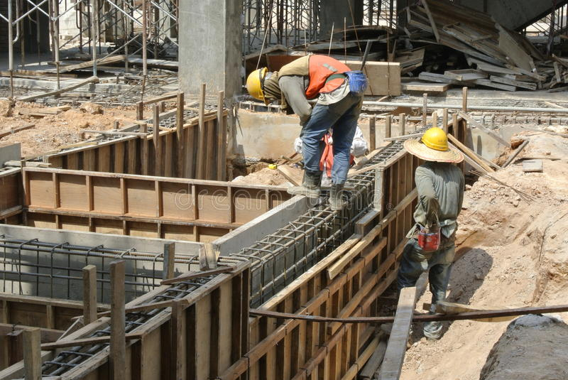 Two Construction Workers Installing Ground Beam Formwork royalty free stock image