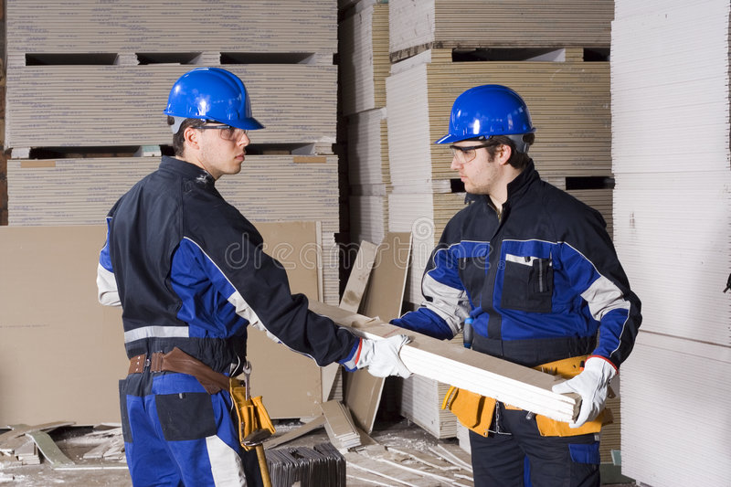 Two construction workers teamwork stock photography