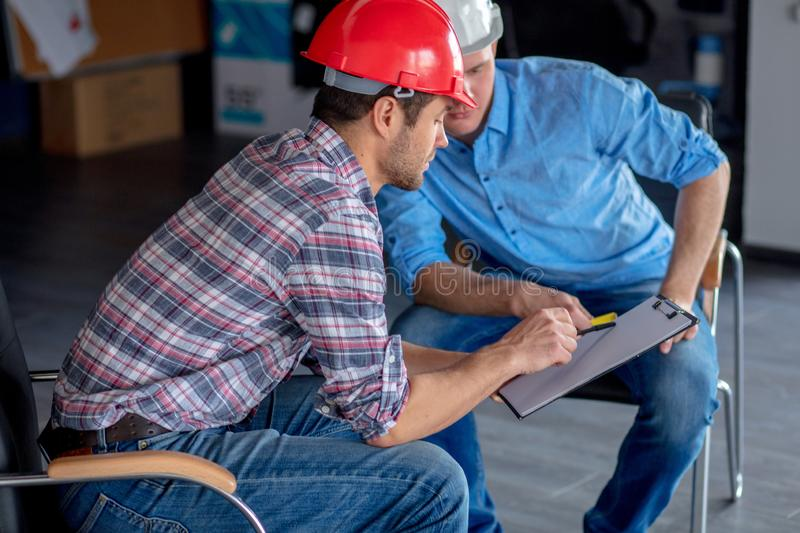Two constructors doing the correction of business project royalty free stock images