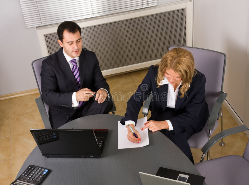 Download Two Contemporary Businesspeople At A Meeting Royalty Free Stock Photography - Image: 7356127