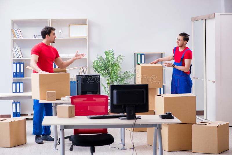 The two contractor employees moving personal belongings stock photography