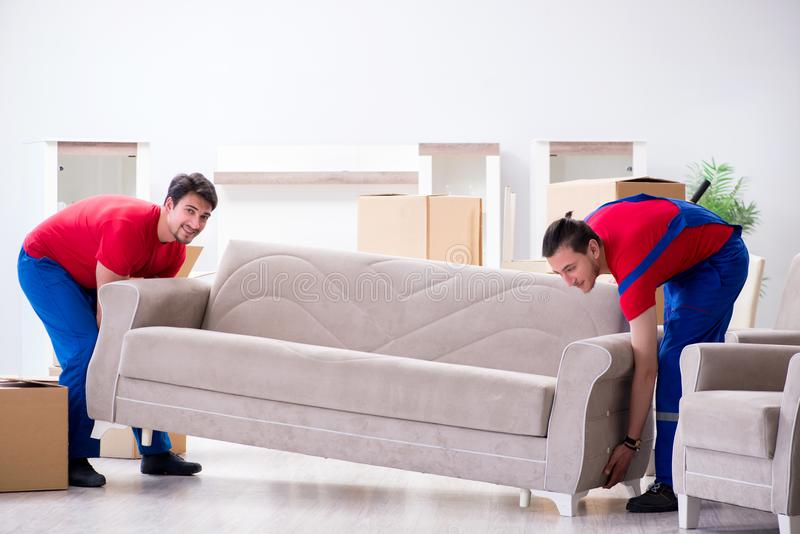 The two contractor employees moving personal belongings. Two contractor employees moving personal belongings stock photography