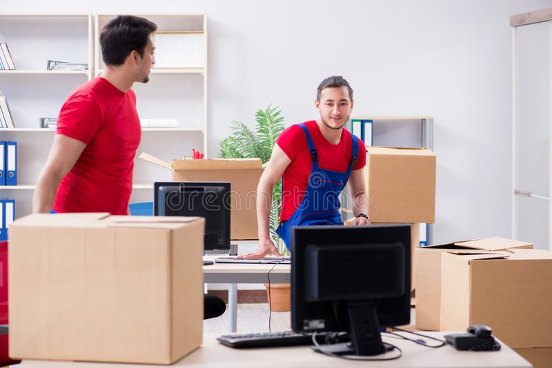 The two contractor employees moving personal belongings. Two contractor employees moving personal belongings royalty free stock photo