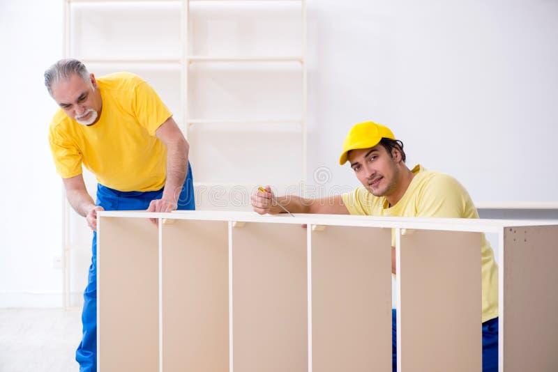 Two contractors carpenters working indoors stock image