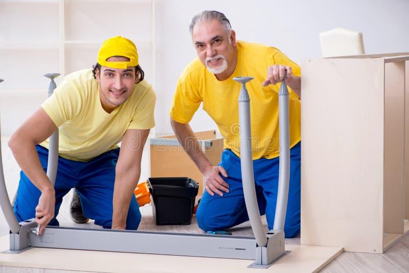 Two contractors carpenters working indoors stock photos