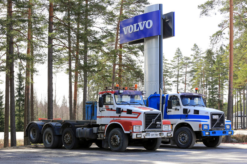 Two Conventional Volvo N12 Trucks under Volvo Sign royalty free stock photo