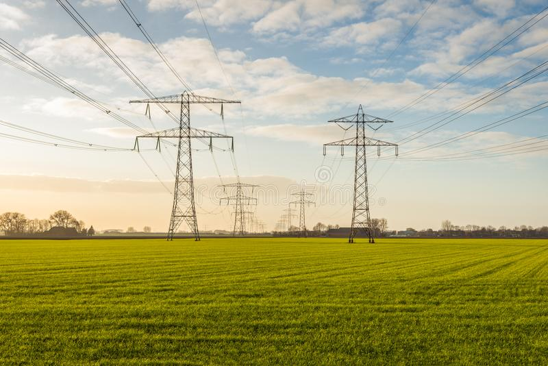 Two converging high-voltage lines in a rural area stock image