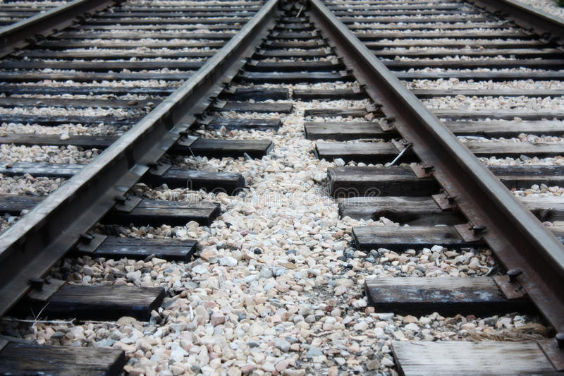 Two converging train tracks stock photo
