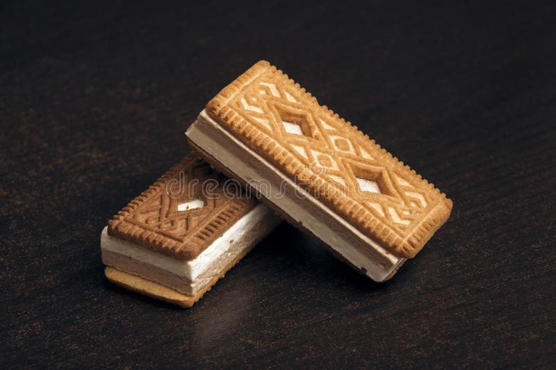 Two cookies with a souffle on a wooden table stock images
