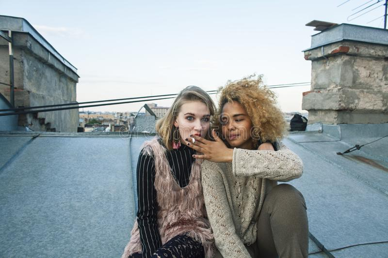 Two cool blond real girls friends diverse nations making selfie on roof top, lifestyle people concept, modern teens. Closeup royalty free stock photos