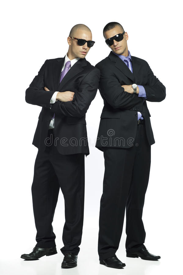 Two cool handsome men. Two handsome stylish men in suits wearing sunglasses stock photos