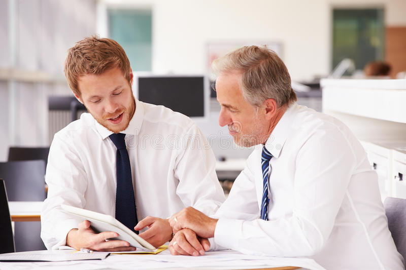 Two corporate business colleagues working together in office royalty free stock images