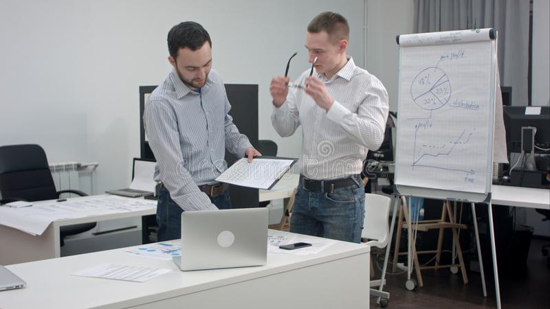 Two corporate executives having business discussion in office stock photos