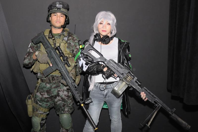 Two cosplayers posing for photo taking. Two cosplayers costumers posing for photo taking by amateur hobbyist photographers. The event was Cosfest 2019 in royalty free stock images