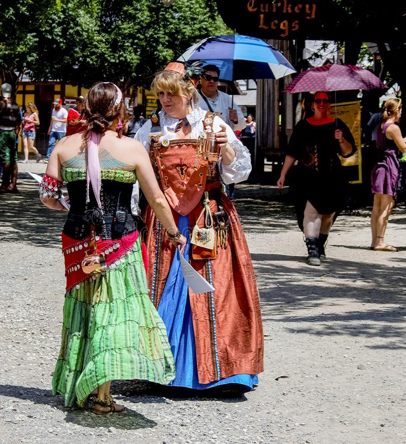 Costumed women chatting at Renaissance Faire in Muskogee Oklahoma USA 5 28 2017 royalty free stock image