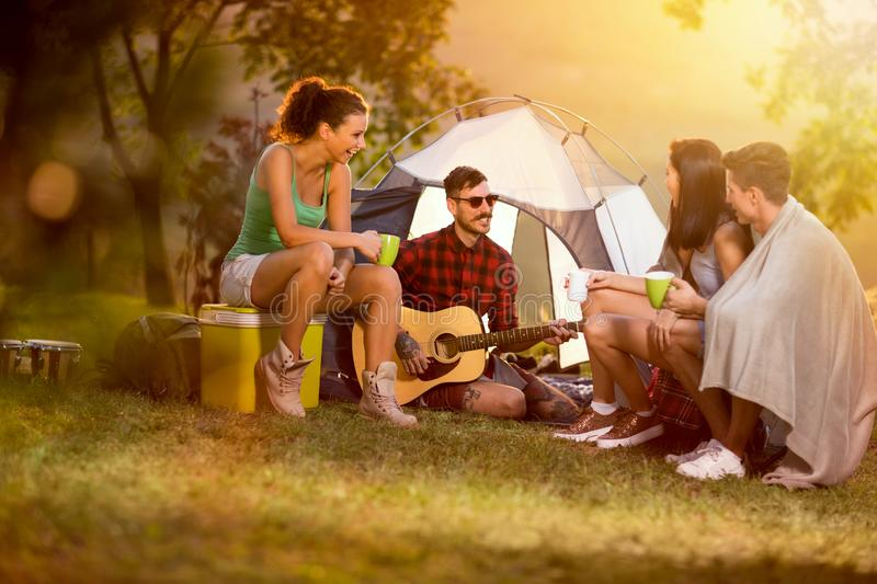Two couples camping together stock images