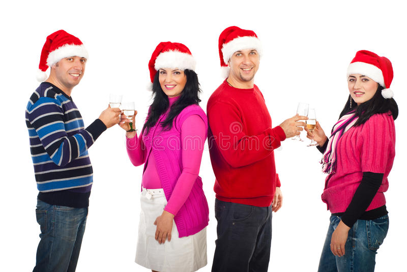 Two couples Christmas toast. Two couples toasting with champagne and celebrate Christmas night isolated on white background royalty free stock image
