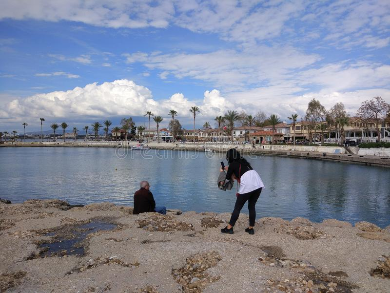 The two couples enjoy the sea in a sunny day. In Antalya Manavgat royalty free stock image