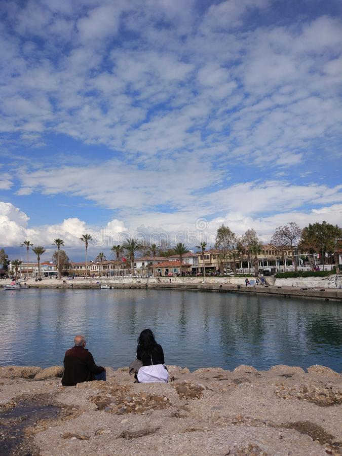 The two couples enjoy the sea in a sunny day. In Antalya Manavgat stock images