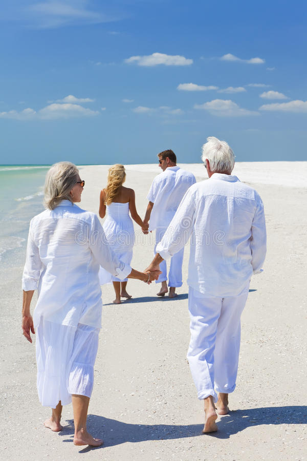 Two Couples Family Generations Walking on Beach stock photography