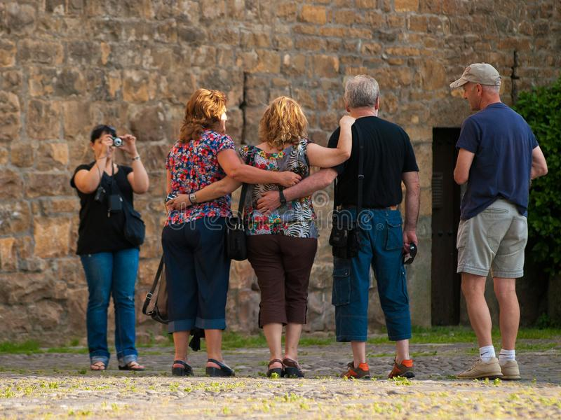 Two couples letting themselves be portrayed by a girl. royalty free stock photo