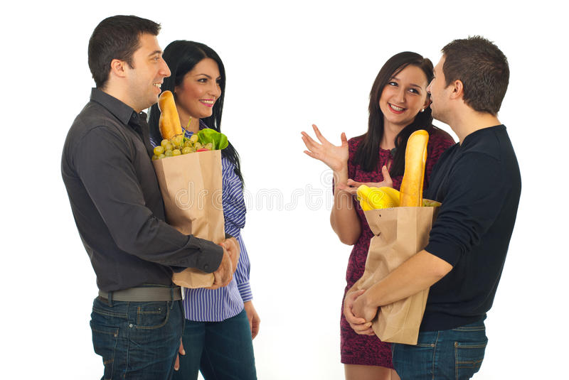 Two couples meeting at shopping for food. Two couple meeting at shopping for food and having conversation isolated on white background royalty free stock photography