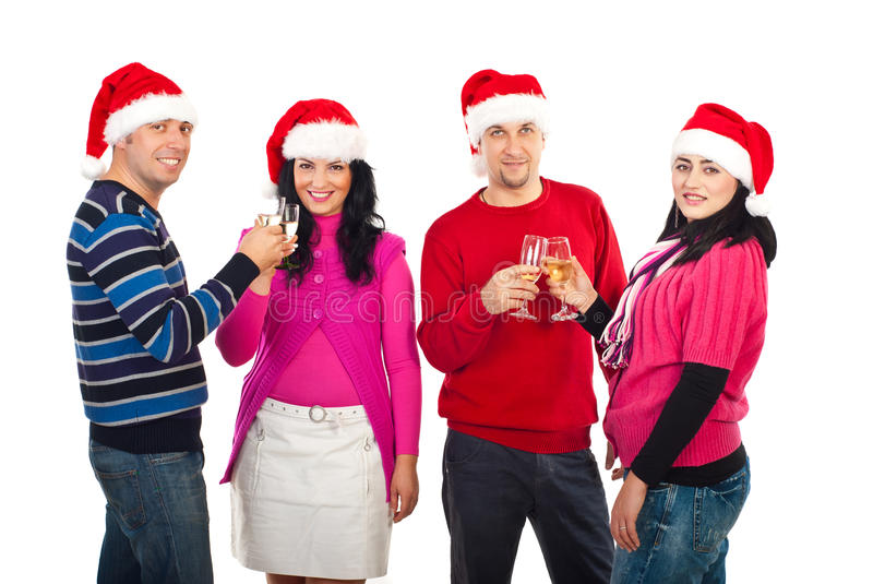 Two couples toast for Christmas. Two couples toasting with champagne and celebrate Christmas night isolated on white background royalty free stock photo
