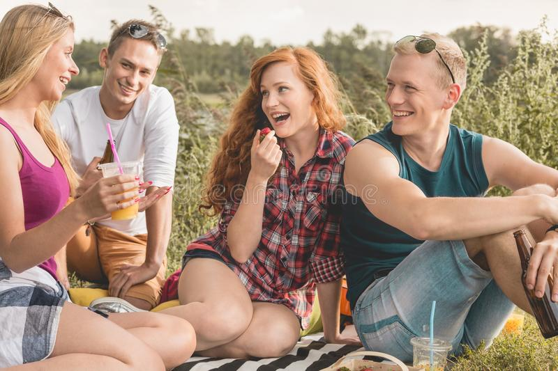 Two couples trip. Two couples enjoying trip with common picnic royalty free stock photo