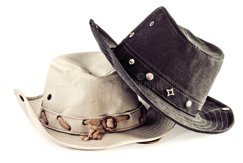 Two cowboy hats isolated on white stock images