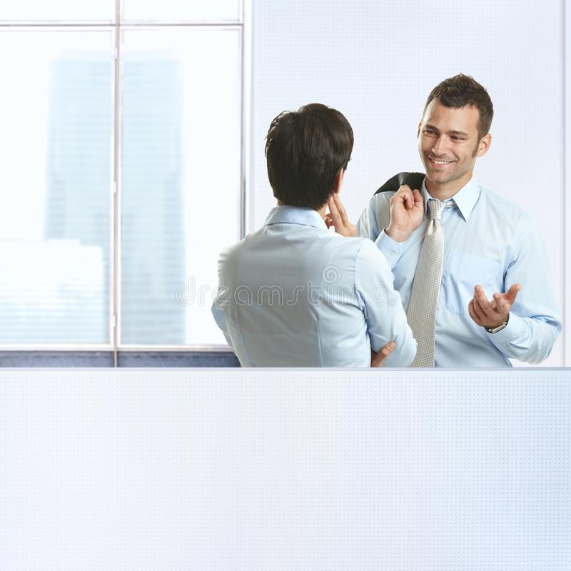 Download Two Coworkers Chatting In Office Stock Photo - Image: 18040084