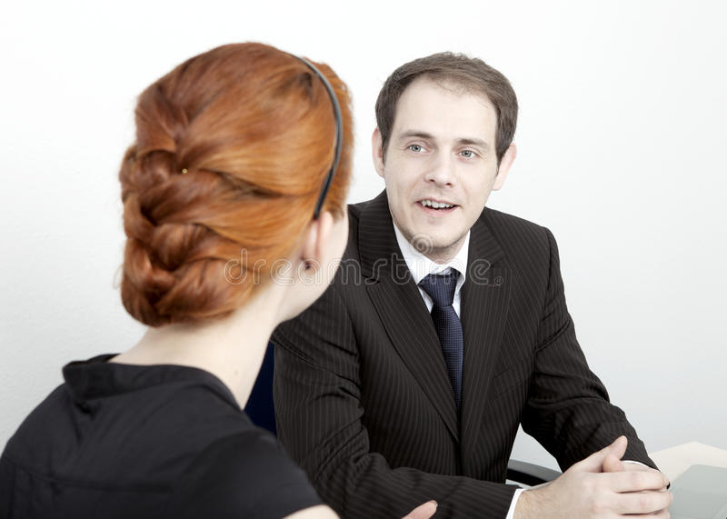 Two coworkers having a discussion royalty free stock image