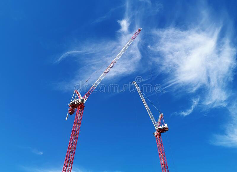 Two cranes and blue sky stock photography