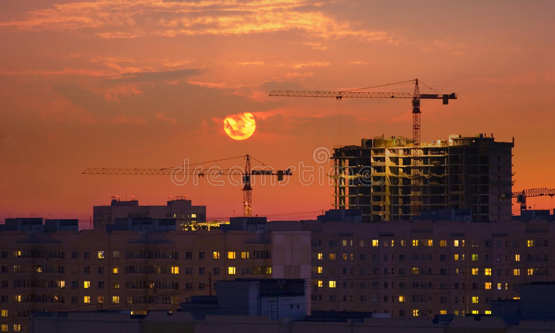 Download Two cranes at evening stock photo. Image of house, occupation - 11127750