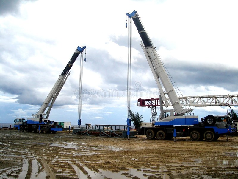 Two Cranes at Work royalty free stock images