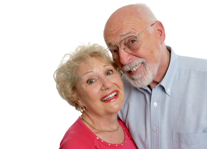 Two Crazy Kids. A happy senior couple who is young at heart. Isolated with room for text