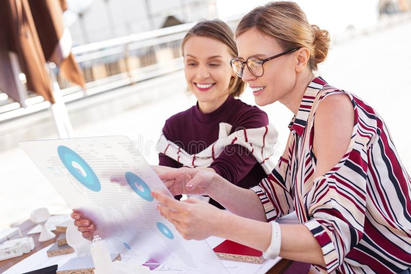 Two creative interior designers looking at apartment scheme royalty free stock photography