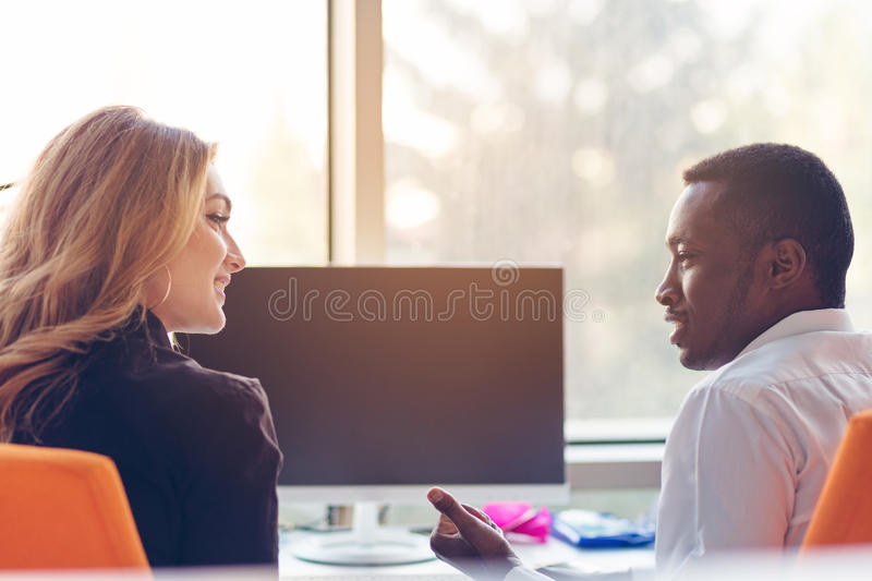 Two creative millenial small business owners working on social media strategy using a computer royalty free stock photos