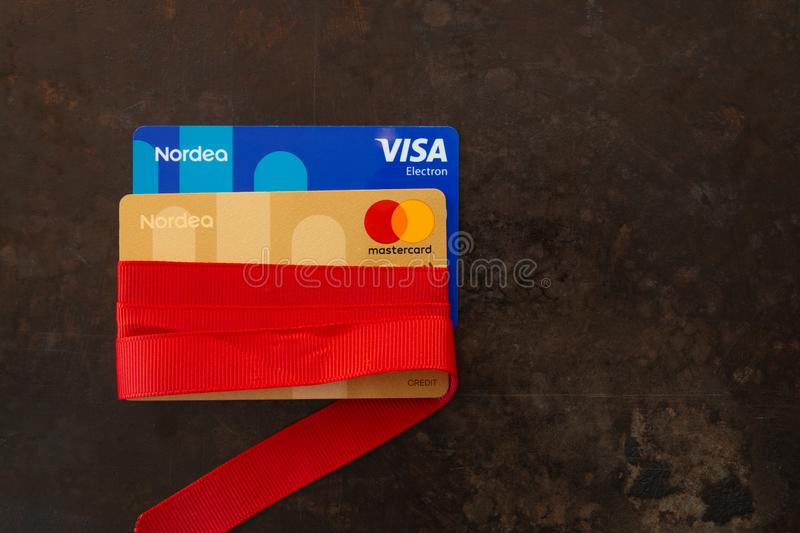 Two credit cards Visa and Mastercard wrapped in red ribbon as a gift stock image