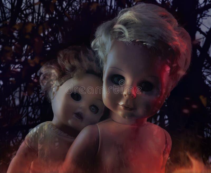 Two creepy dolls, halloween concept royalty free stock photo