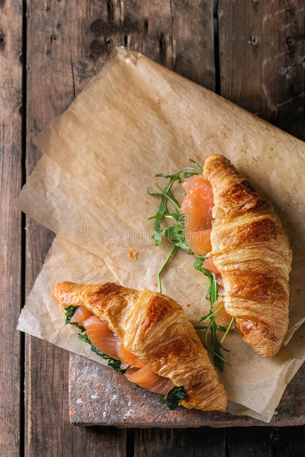 Two croissant with salmon stock photo. Image of nutrition..