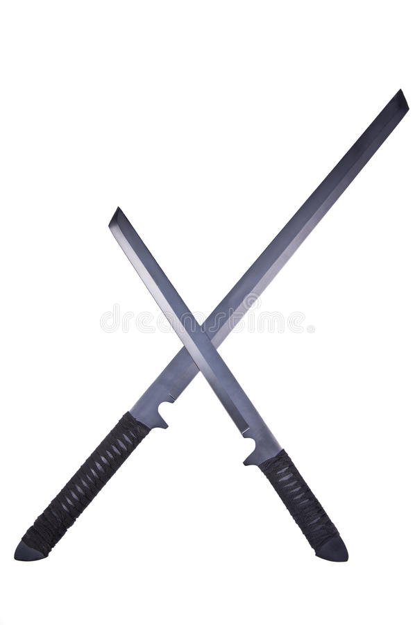 Two crossed ninja swords stock photography