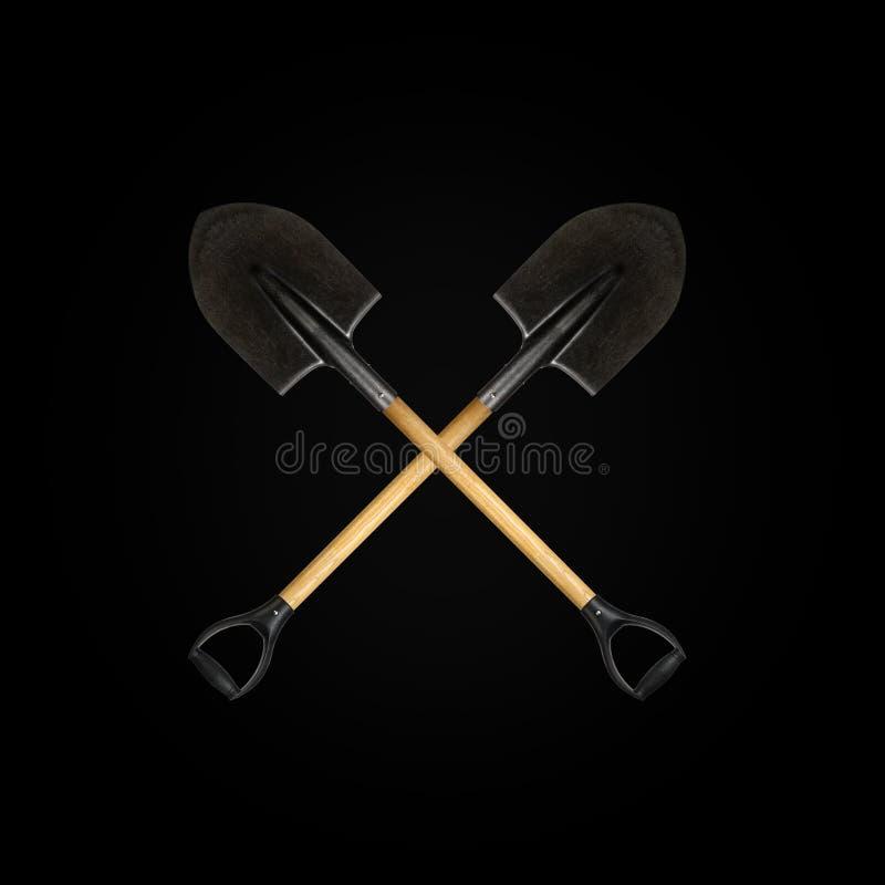 Two crossed shovel black background stock images
