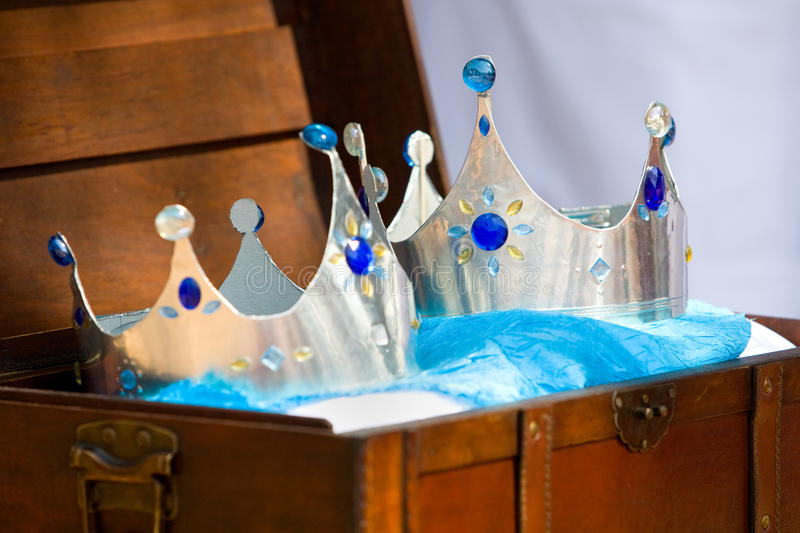 Two crowns. A horizontal photo of two plastic crowns in a leather chest, used for symbolic reasons on a wedding day royalty free stock photography