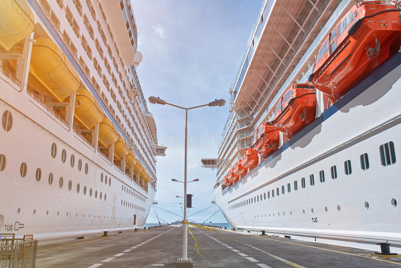 Two cruise ships. Docked on pier on sunny days royalty free stock photo
