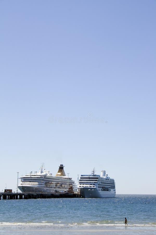 Two cruises docked stock photography