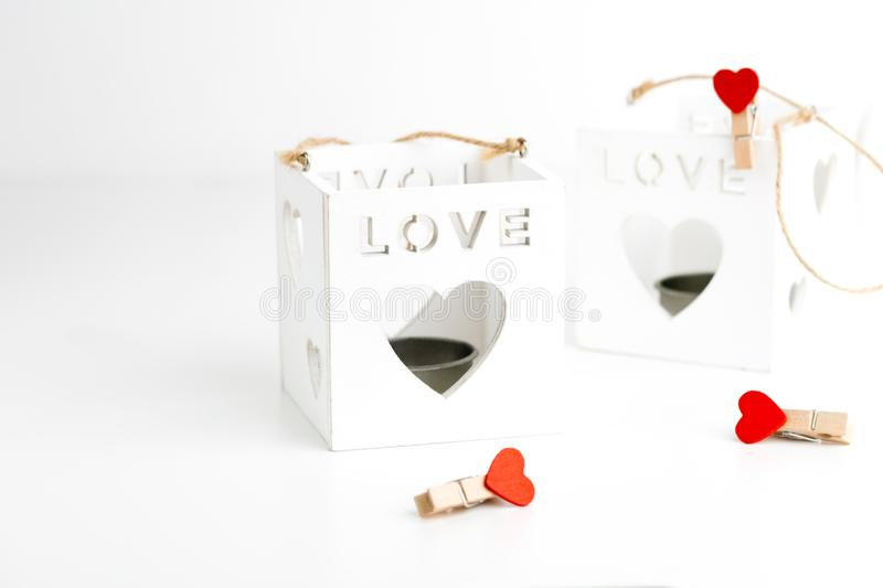 Two cube candlesticks on white with hearts. Valentines Day concept. 14th February stock image