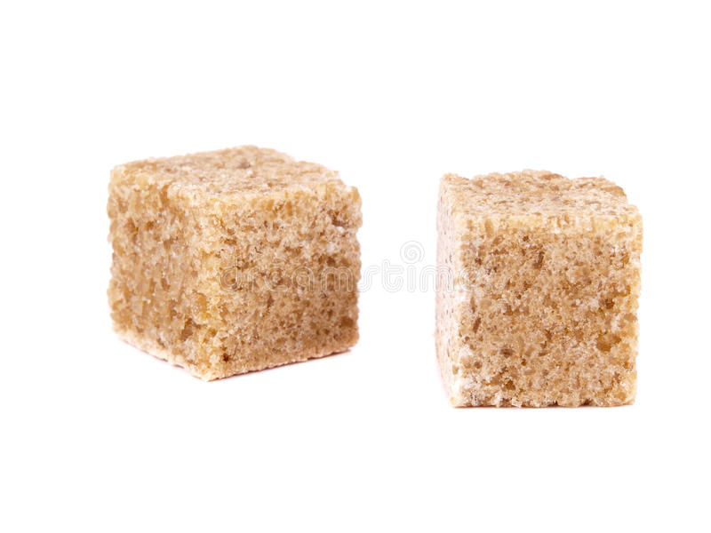 Two cube of cane sugar stock photography