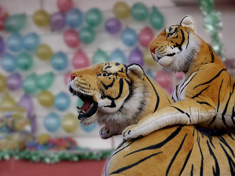 Cudly tigers on a fairground stall. stock photography