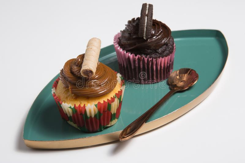 Two cup cakes. Two delicious cup cakes. Freshly baked stock photos