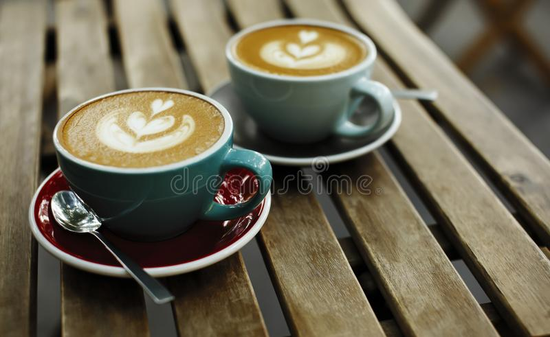 Two cup of coffee on wooden background. Breakfast morning concept in cafe royalty free stock image